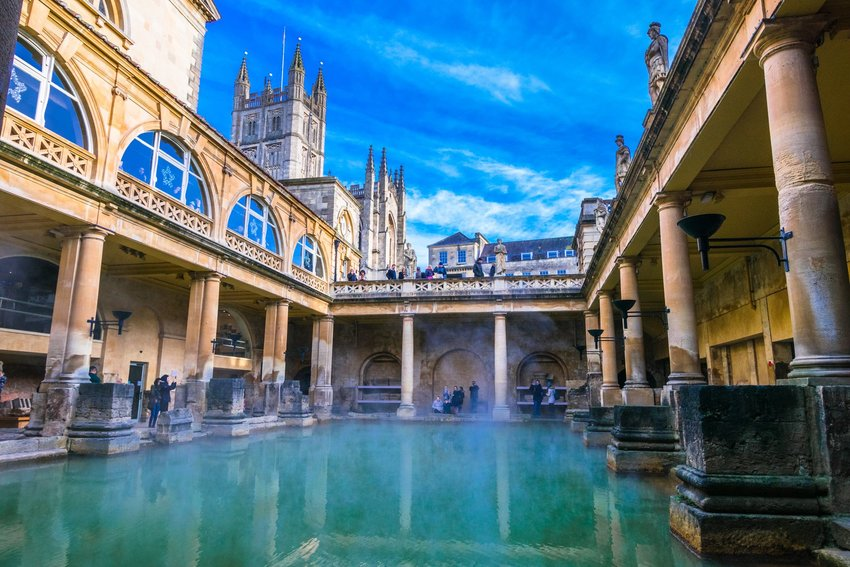 Photo of an old bath surrounded by a courtyard