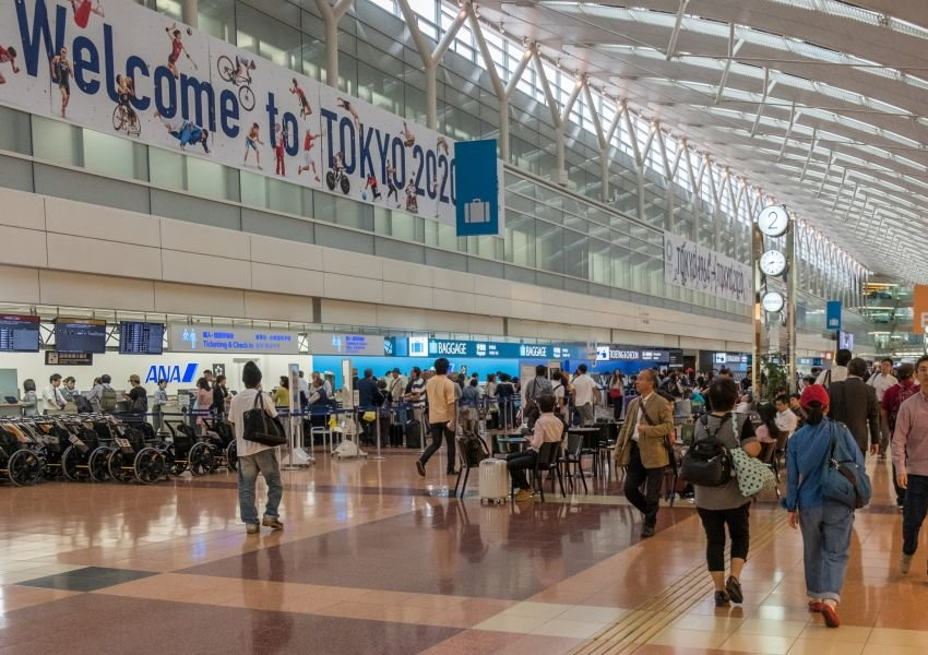 Airport with a banner that reads welcome to Tokyo 2020
