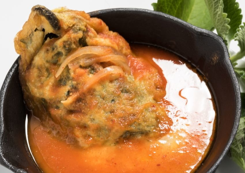 Photo of a Chiles Rellenos dish in a cast iron skillet