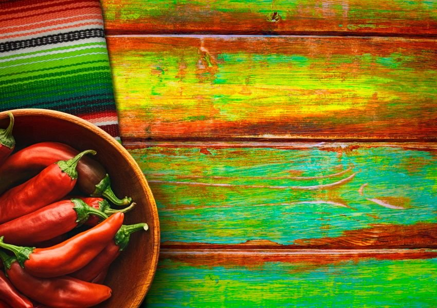 Photo of hot peppers on a colorful wooden background