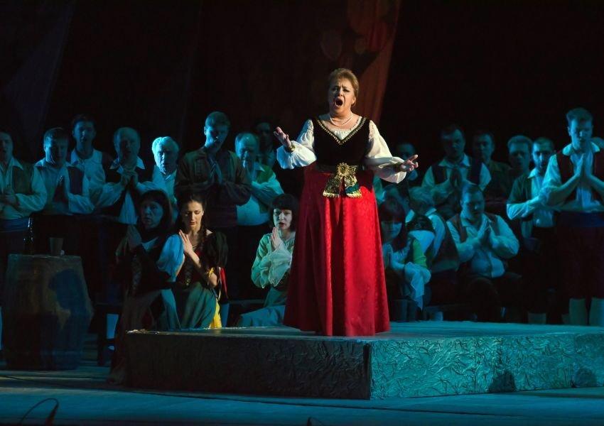 Opera singer performing in the spotlight