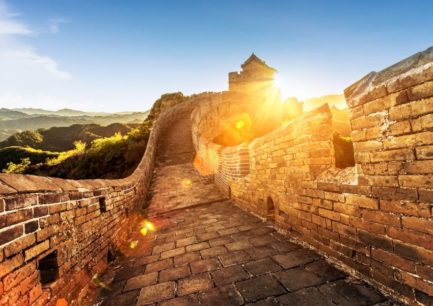 Photo taken from on top the Great Wall, with bright sun in the background
