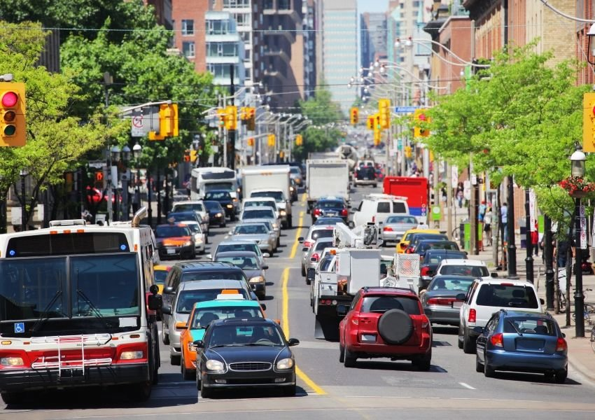 Photo of heavy traffic driving on a city street