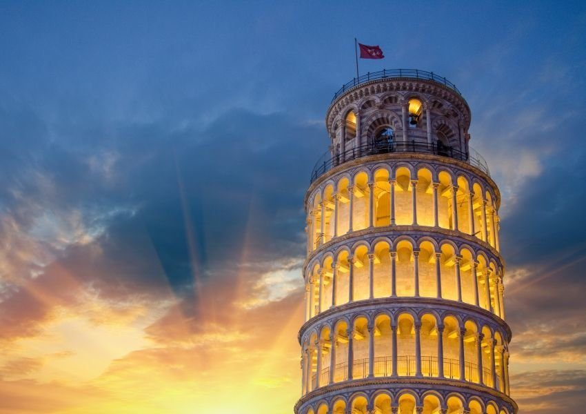 Photo of the top of the Leaning Tower of Pisa in front of a beautiful sunset
