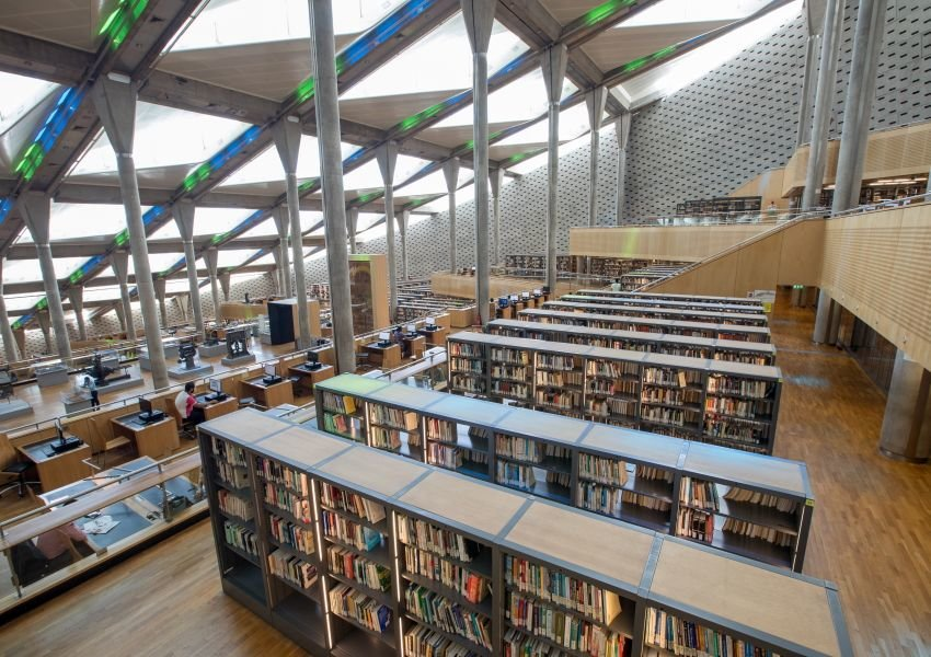 Photo of modern shelves and architecture inside the Bibliotheca Alexandrna in Egypt