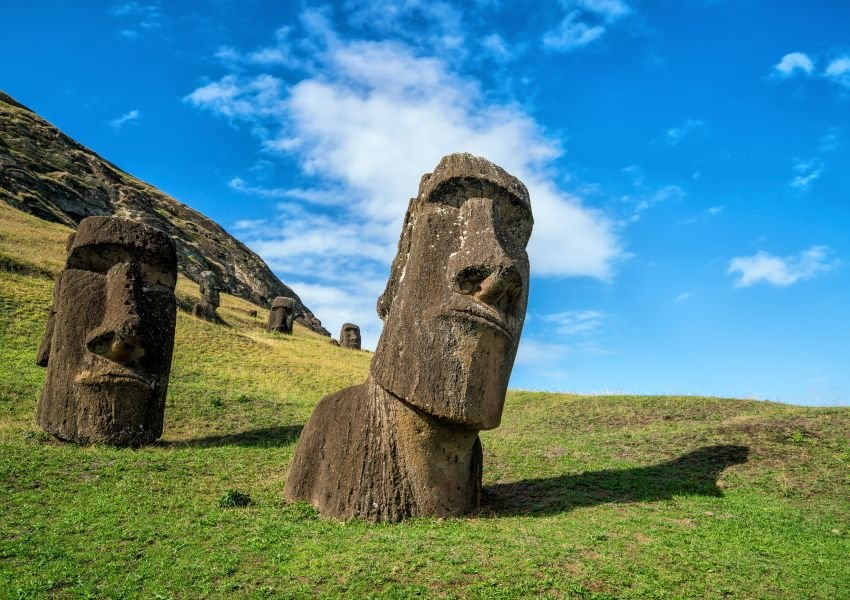 Photo of the iconic Easter Island statue heads on a grassy field