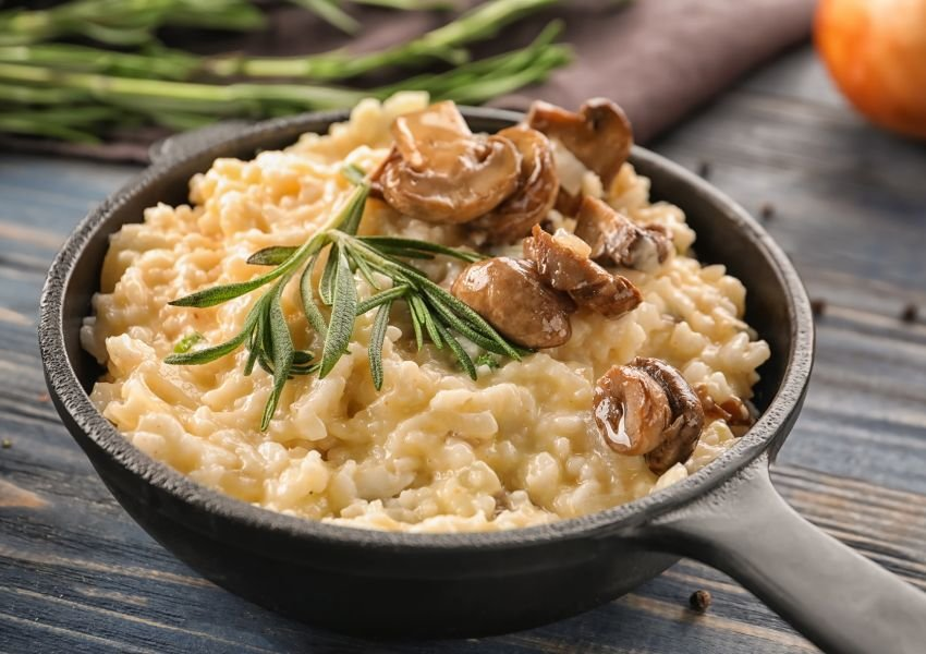 Photo of a bowl of risotto topped with mushrooms