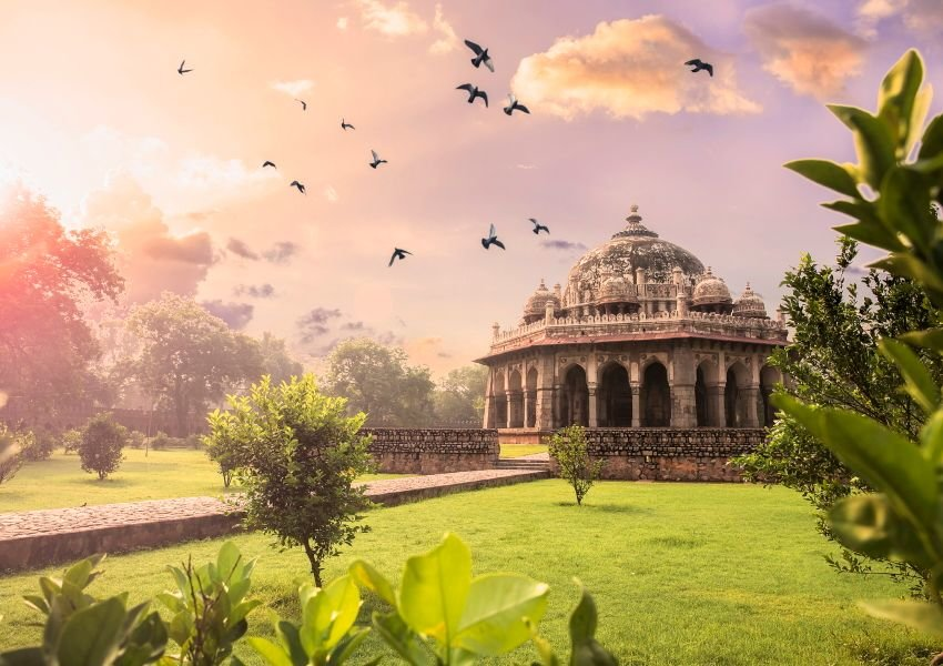 Photo of an Indian temple surrounded by lush greenery