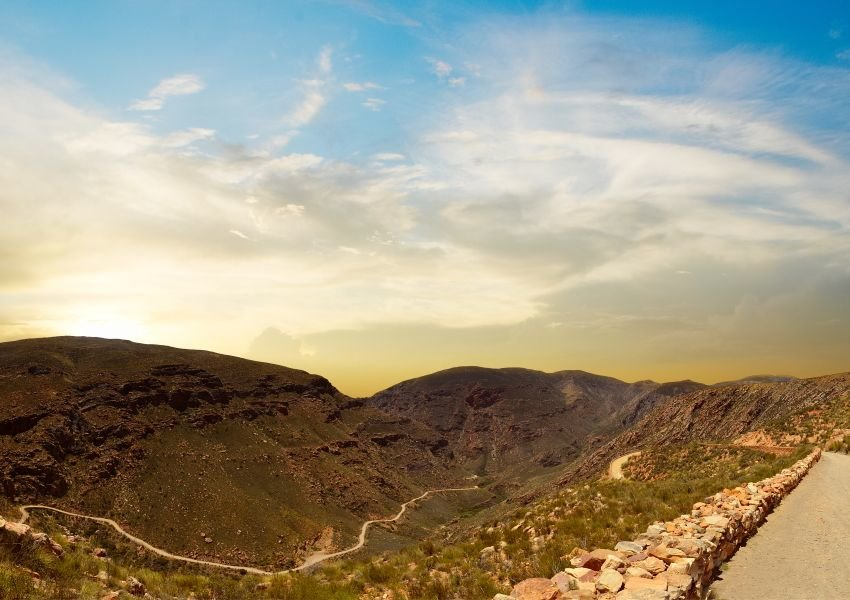 Photo of trail alongside mountain range
