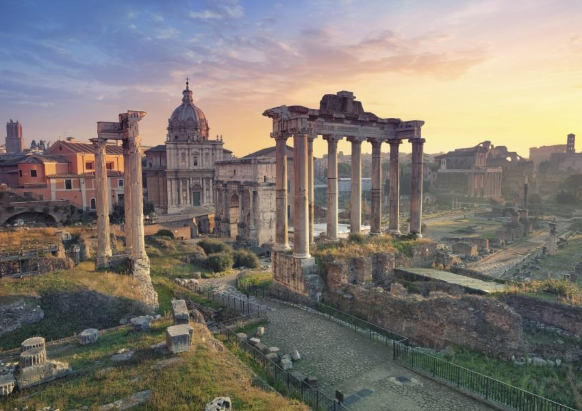 Photo of ancient Roman ruins in front of a beautiful sunset