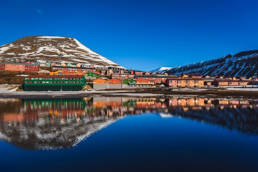 Lakeside village and winter mountains in Longyearbyen, Norway