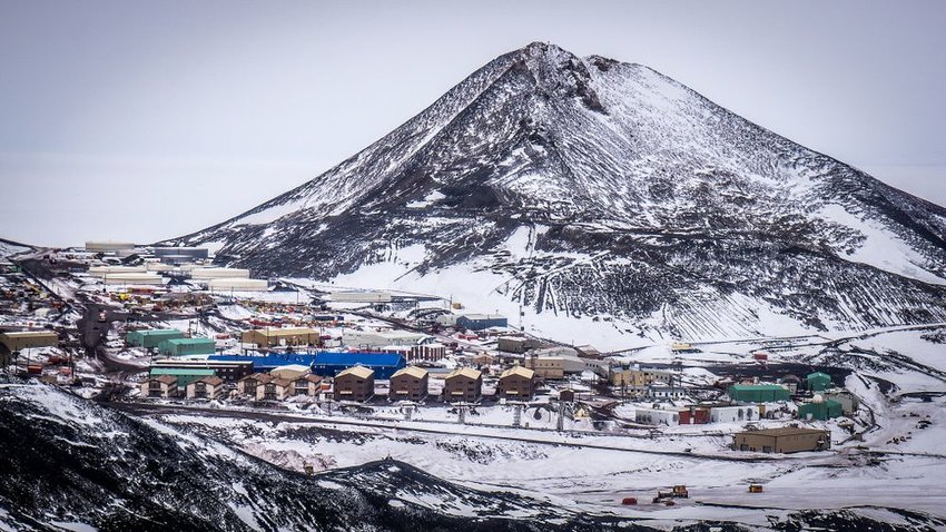 Snowy landscape showing the McMurdo Station on Observation Hill, Antarctica