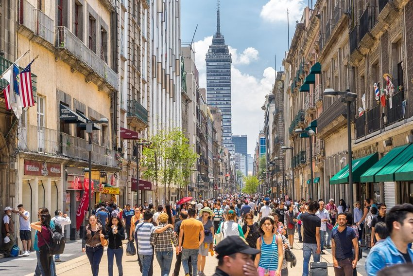 Street view of a crowded avenue in Mexico City on a bright afternoon