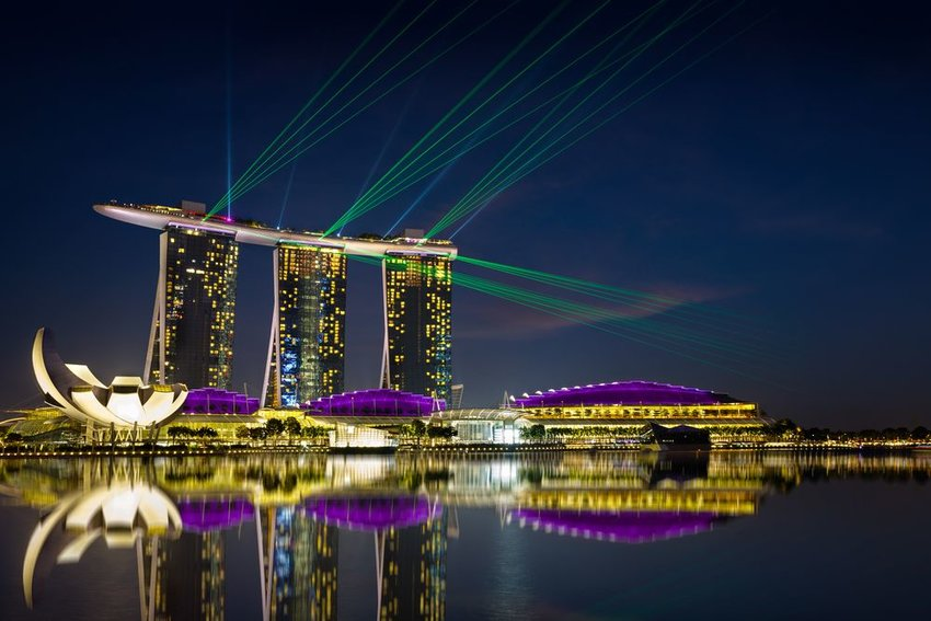 Night view of the Marina Bay Sands resort during a laser light show