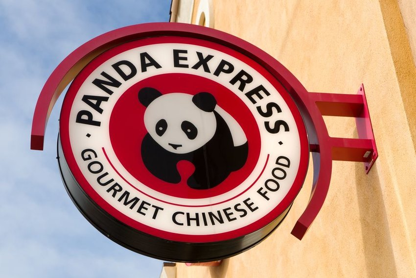 Street view of red and white Panda Express sign outside restaurant on a clear day