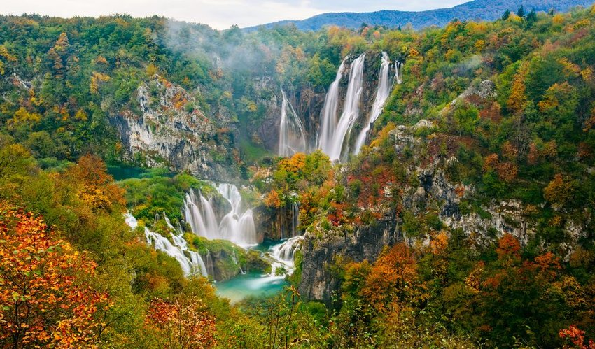 Aerial view of natural landscape, trees, and waterfalls at the Plitvice National Park, Croatia