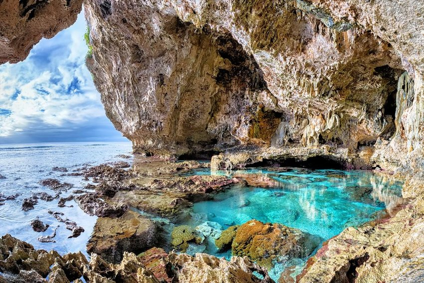 Photo of a rocky cave on the coast of the ocean