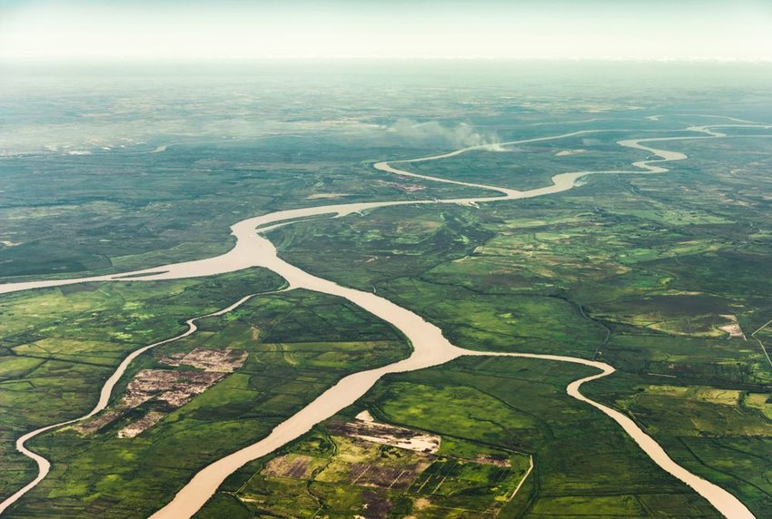 Aerial photo of Amazon River winding across landscape