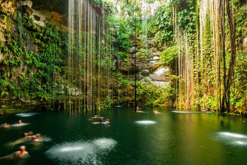Photo of people swimming in a cenote
