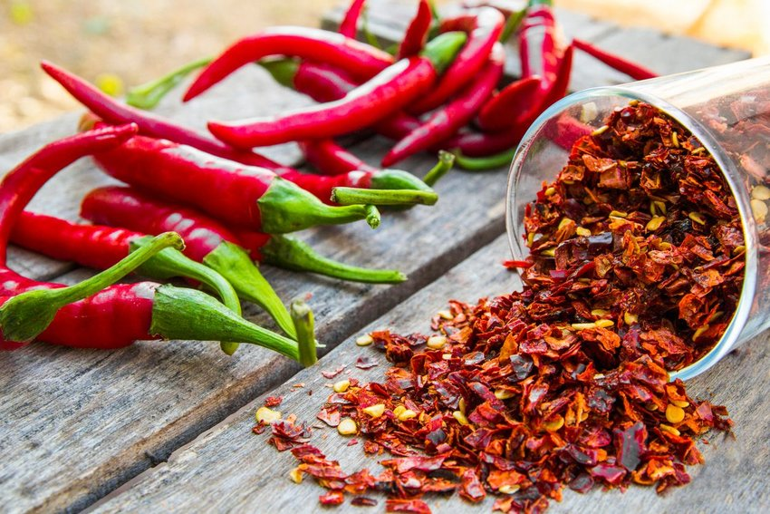 Photo of red chili peppers and flakes