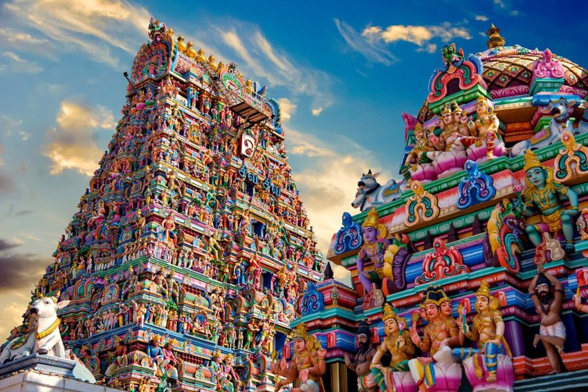 Photo of a colorful Indian temple covered in statues