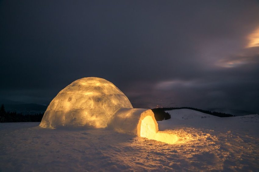 Photo of an igloo illuminated from within