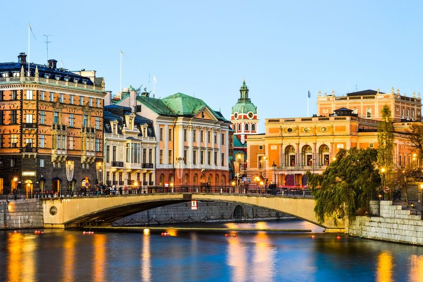 Charming Swedish city and waterways, lit at dusk