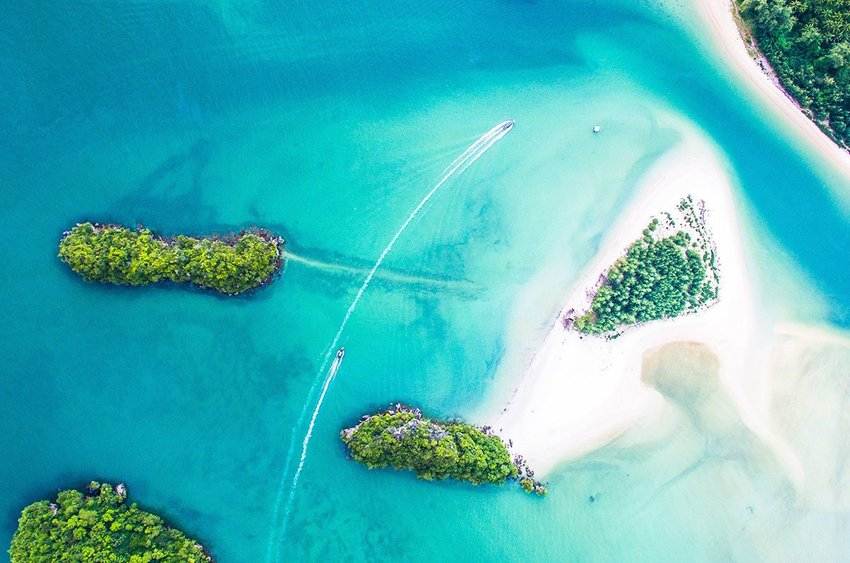 Aerial photo of a tropical sea with sand bars and greenery