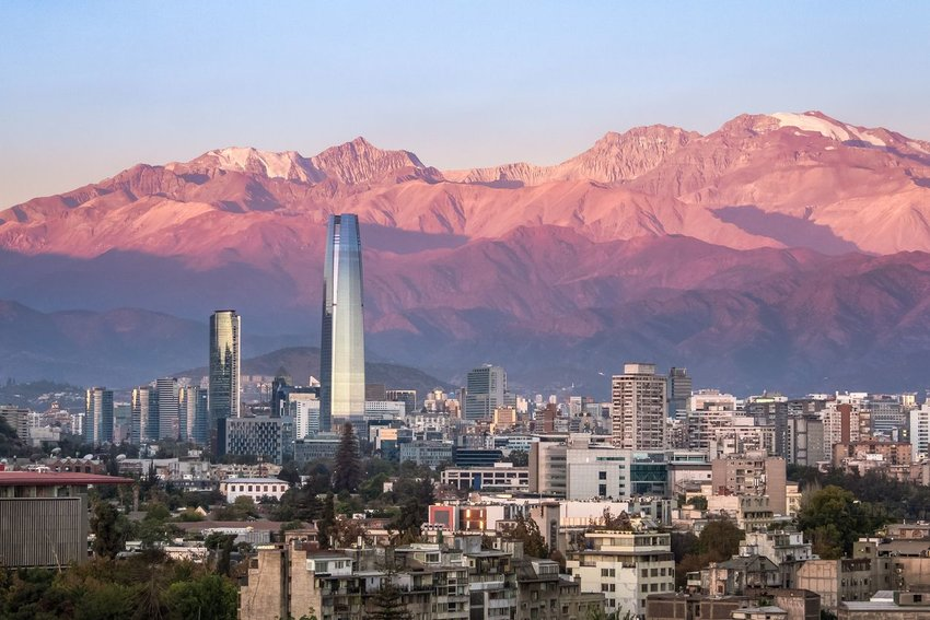 Santiago, Chile skyline at sunset with the Andes Mountains in the background