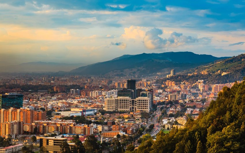 Capital city of Bogota, Colombia at sunset with mountains in the distance