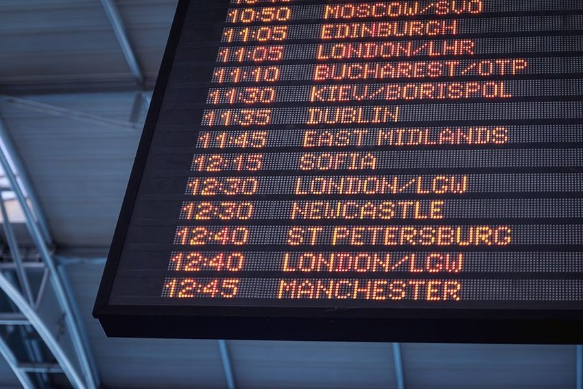 Photo of a board displaying departure times and city names