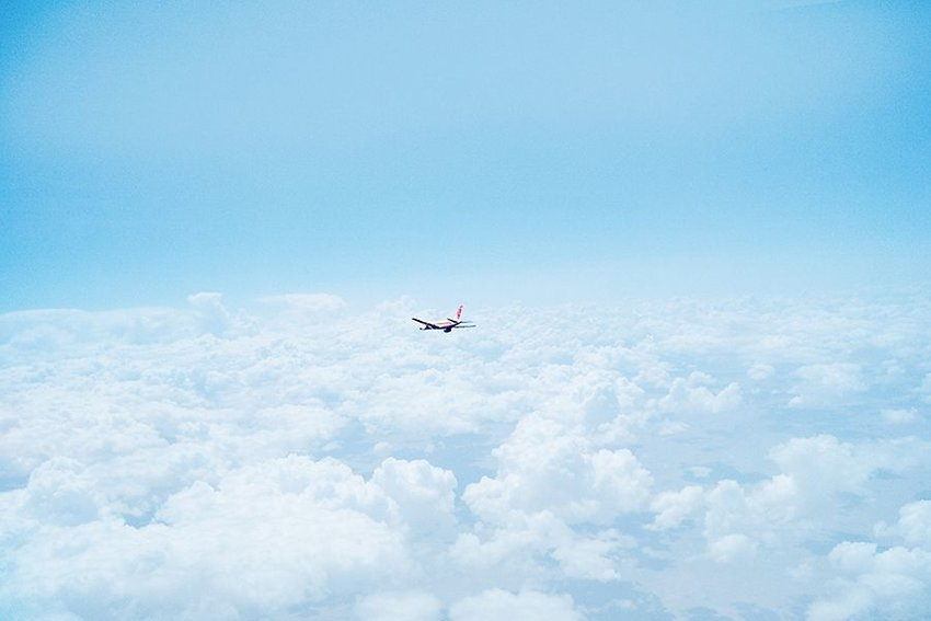 Photo of an airplane flying through the sky
