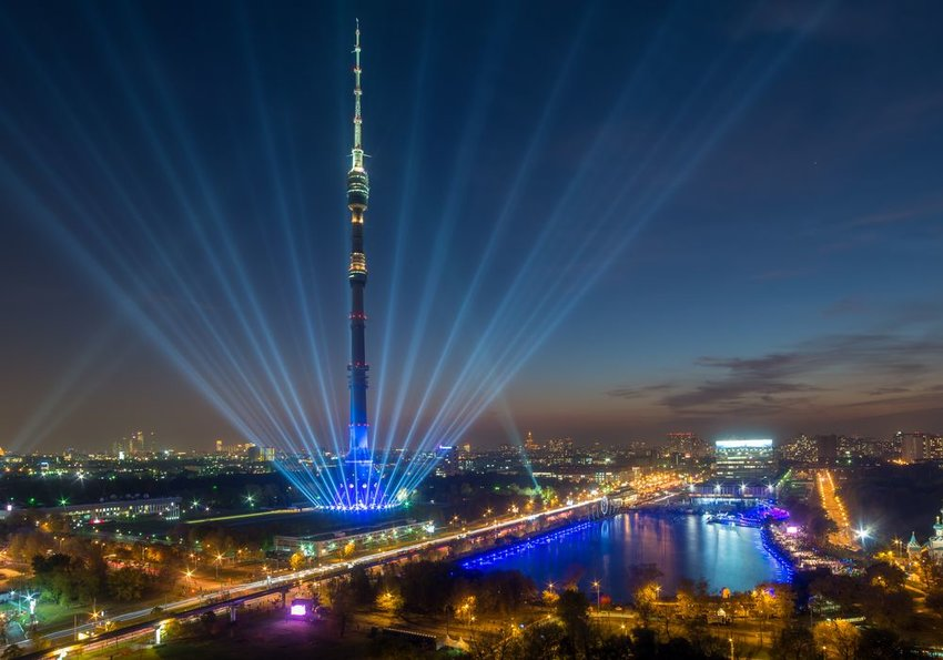 Aerial view of the Ostankino Tower with blue laser lights seen at night, Moscow, Russia