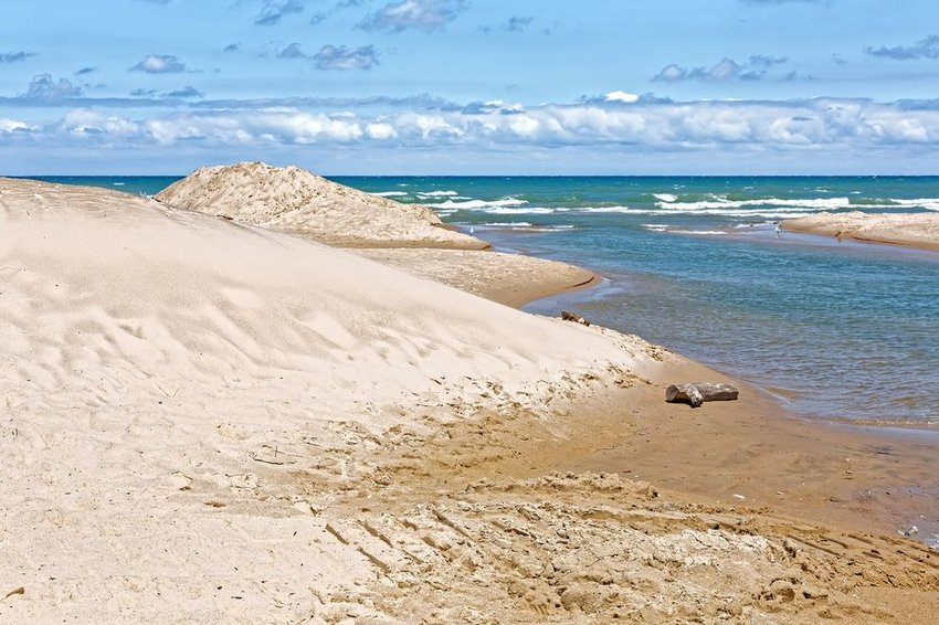Indiana Dunes National Park shoreline with lapping waves and clouds, Indiana