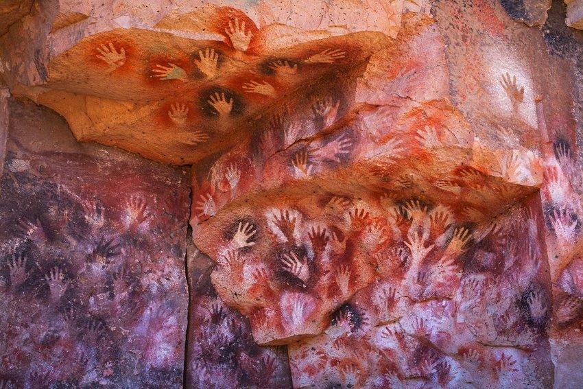 Cave paintings of handprints in the Cueva de las Manos, Patagonia, Argentina