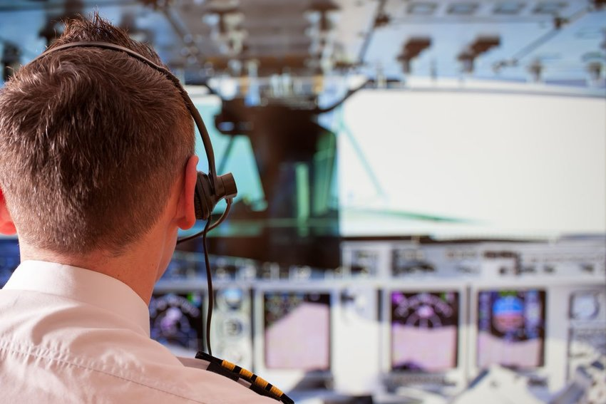 Pilot wearing headset communicating with control tower
