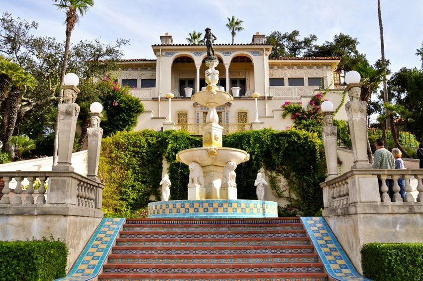 View of a guest mansion and water fountain at the Hearst Castle, San Simeon, California