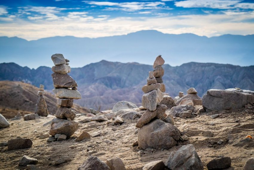 Stacking stones piled on a mountain ridge in the Mecca Hills region of California