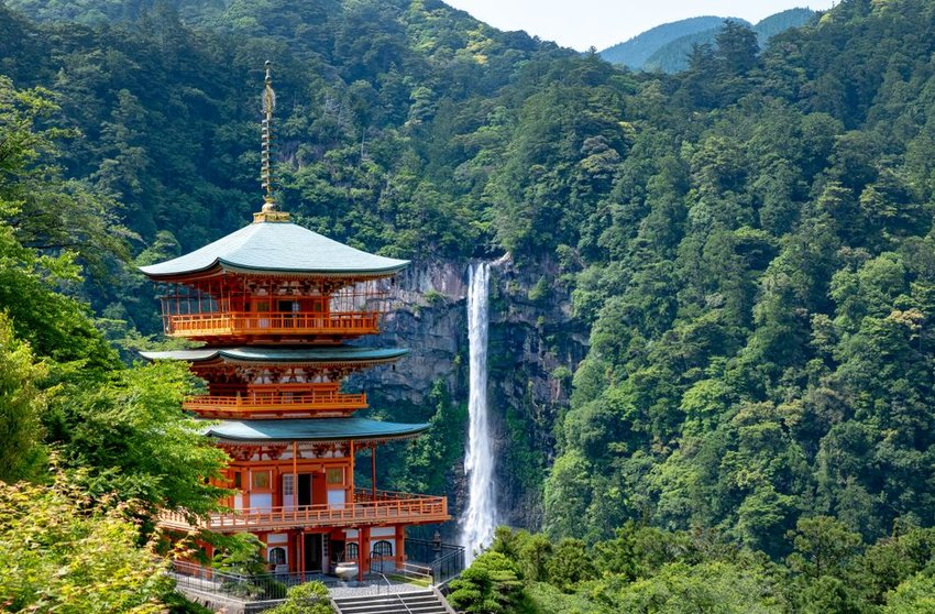 Aerial view of traditional shrine surrounded by forests and mountains at Nachi Falls