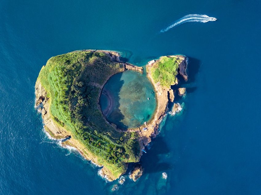 Aerial view of old crater island surrounded by blue waters, San Miguel island, Azores, Portugal