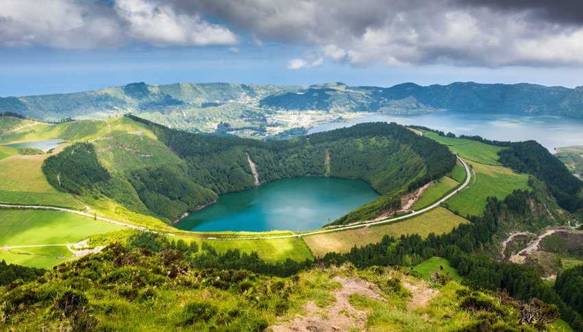Aerial view of large crater lake within lush green island, Sete Cidades, Azores, Portugal