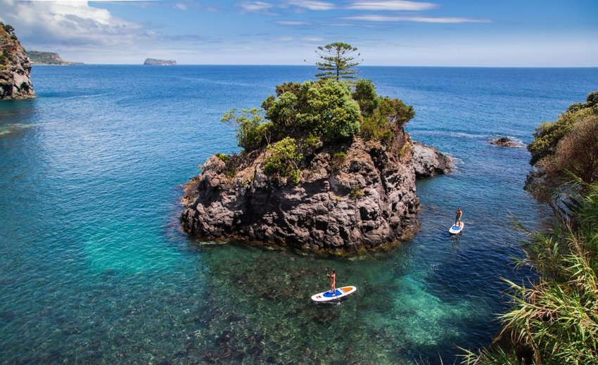 Aerial view of Azores landscape with craggy rocks and clear blue waters in Portugal