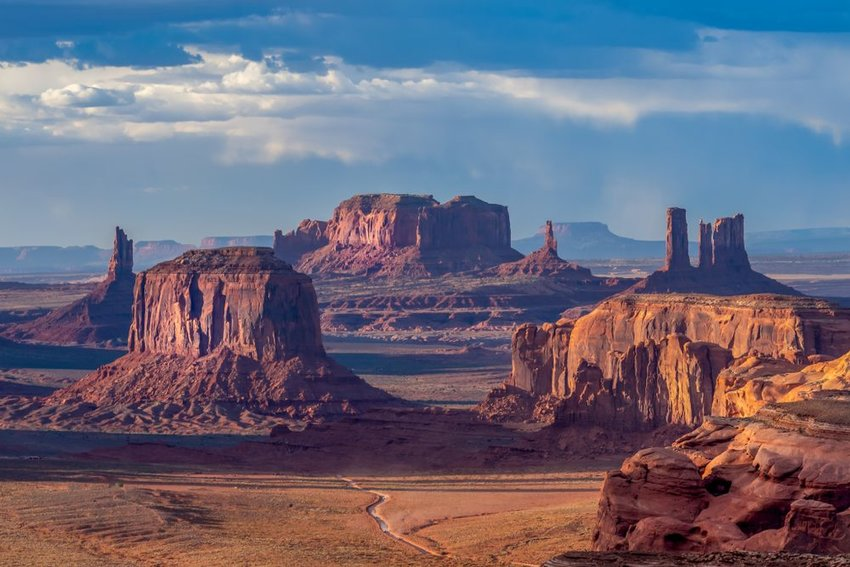 Aerial view of Monument Valley in Navajo Nation with clouds in sky