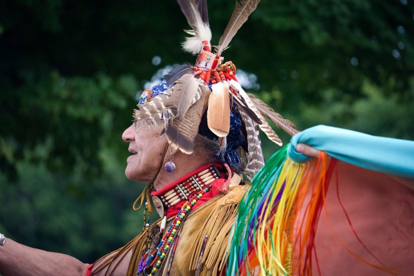Pokanoket Wampanoag tribe member with traditional clothes and feather headdress
