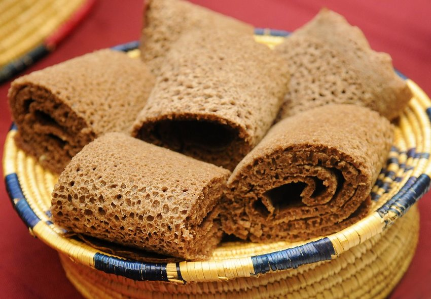 Basket of traditional Ethiopian injera bread rolled up ready for serving