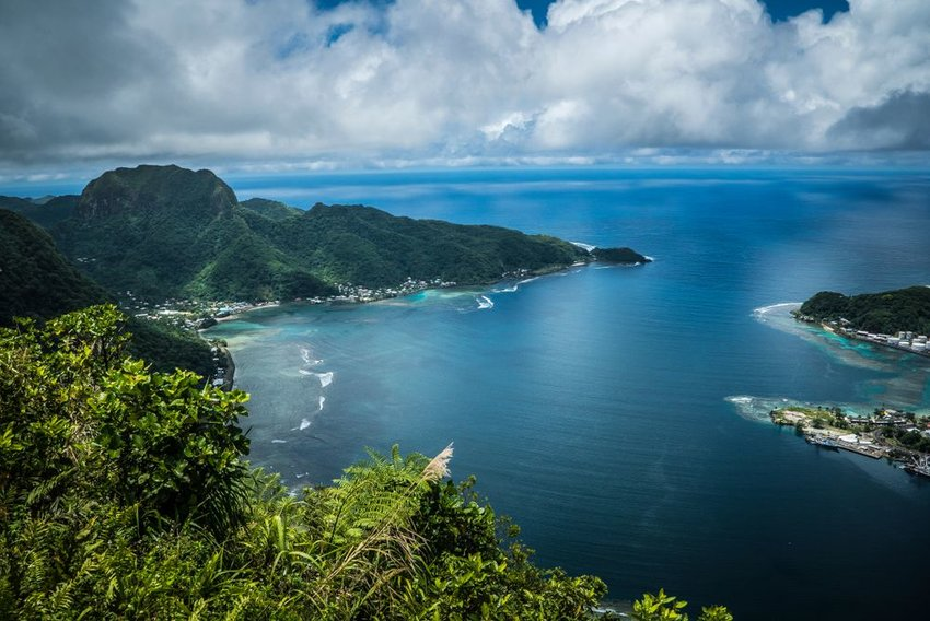 Aerial view of American Samoa island Pago Pago's dense forest canopy and sandy beaches