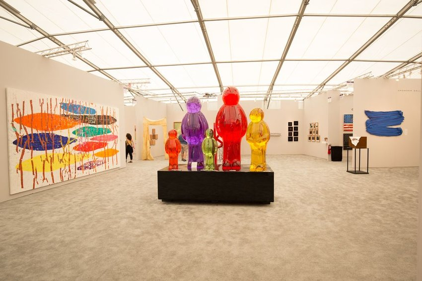 Interior of open exhibit with multicolored pieces at the Art Basel show, Miami, Florida