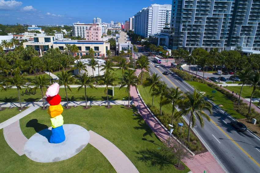 Aerial view of Art Basel grounds with Florida palm trees and bright, multicolored rock art exhibition