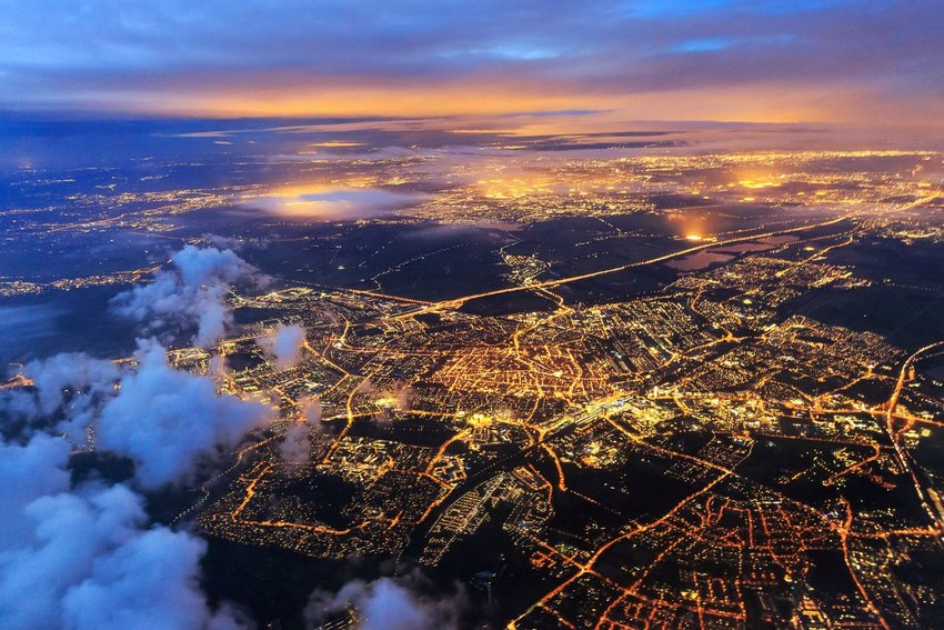 Aerial view of city lights at night from a plane