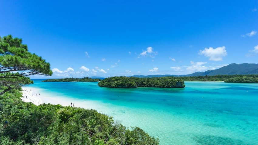 Clear turquoise water and coral rock islands in Kabira Bay, Ishigaki Island National Park of the Yaeyama Islands
